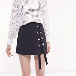 Skirt with shorts and front lace up detail
